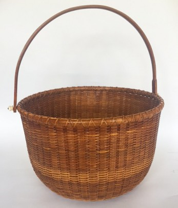 William Severns (1916-2001) Large Round Swing Handle Nantucket Basket, Dated 1990 with penny on base.