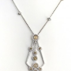 18k White Gold and Diamond Pendant, set with 9 yellow diamonds and 159 round diamonds and 4 diamond roundels on an 18k gold chain.